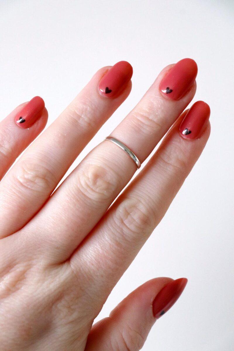 Tiny Gold and Black Hearts Nail Tattoos